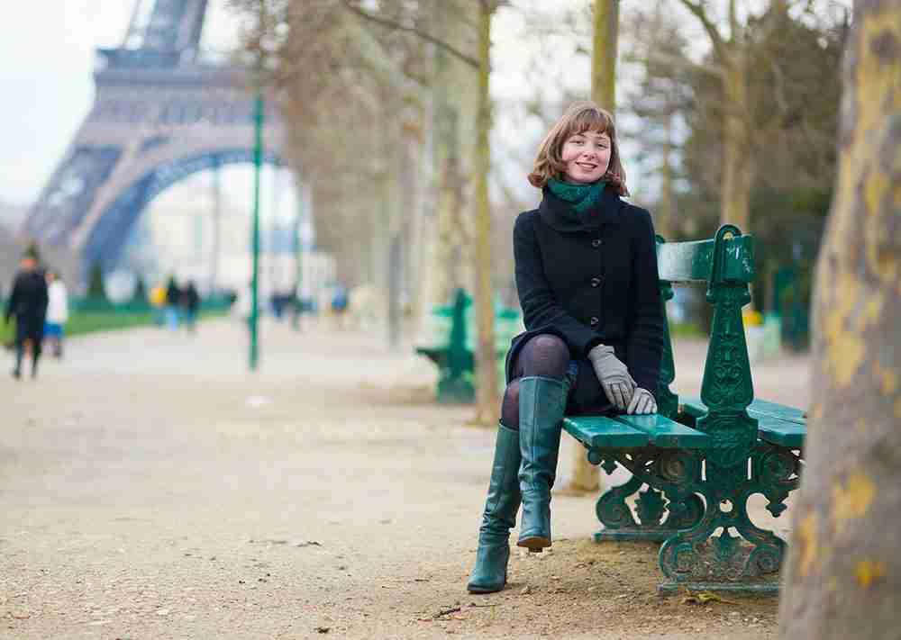 traveler eiffel in the back in paris in france